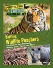 Battling Wildlife Poachers : The Fight to Save Elephants, Rhinos, Lions, Tigers, and More - Book