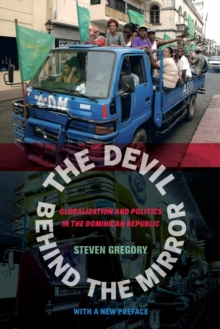 The Devil behind the Mirror : Globalization and Politics in the Dominican Republic, Paperback Book
