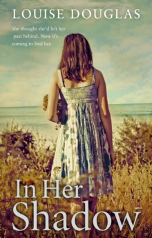 In Her Shadow, Paperback Book