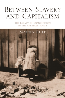 Between Slavery and Capitalism : The Legacy of Emancipation in the American South, Paperback Book