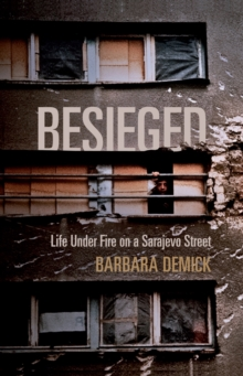 Besieged : Life Under Fire on a Sarajevo Street, Paperback Book
